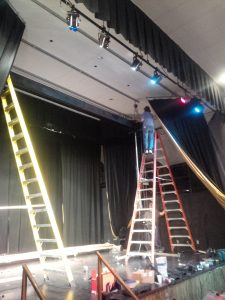 An 18-foot ceiling makes tall ladders a necessity. We prepped the mounting points prior to the install crew's arrival